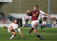 Photo: Lee Earle. <br /> Northampton Town v Swindon Town. Coca Cola Championship. 11/08/2007. <br /> Swindon's Michael Pook (L) has his shot blocked by Mark Hughes.