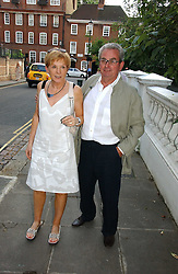Left, ANNE ROBINSON and her husband JOHN PENROSE at Sir David & Lady Carina Frost's annual summer party held in Carlyle Square, Chelsea, London on 5th July 2006.<br />