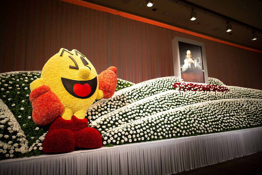"""TOKYO, JAPAN - MARCH 21 : Flowers surround a portrait to commemorate the late Masaya Nakamura, The founder of video game company Bandai Namco and known as the """"father"""" of Pac-Man during the memorial ceremony in Tokyo, Japan on March 21, 2017. (Photo by Richard Atrero de Guzman ANADOLU Agency)"""