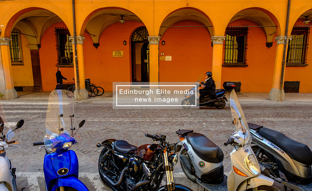 A man on a moped speeds along a street in Bologna, Italy<br /> <br /> (c) Andrew Wilson | Edinburgh Elite media