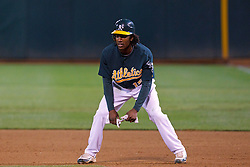 June 28, 2011; Oakland, CA, USA; Oakland Athletics second baseman Jemile Weeks (19) leads off first base against the Florida Marlins during the eighth inning at the O.co Coliseum.  Oakland defeated Florida 1-0.