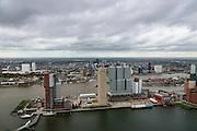 Nederland, Zuid-Holland, Rotterdam, 23-10-2013; Kop van Zuid met Rijnhaven. Op de Wilhelminakade (vlnr) Hotel New York, Montevideo, Las Palmas (het lage witte gebouw, met NFM, Nederlands fotomuseum), New Orleans, en het blauwgrijze gebouw De Rotterdam (verticale stad van OMA/Rem Koolhaas). <br /> Verder de Toren op Zuid en het Nieuwe Luxor Theater.<br /> Nieuwe Maas met binnenstad Rotterdam met skyline in de achtergrond.<br /> Kop van Zuid - Head of South (Rotterdam), former harbour area, newly developed. High rise buildings, renowned architecture.<br /> luchtfoto (toeslag op standard tarieven);<br /> aerial photo (additional fee required);<br /> copyright foto/photo Siebe Swart
