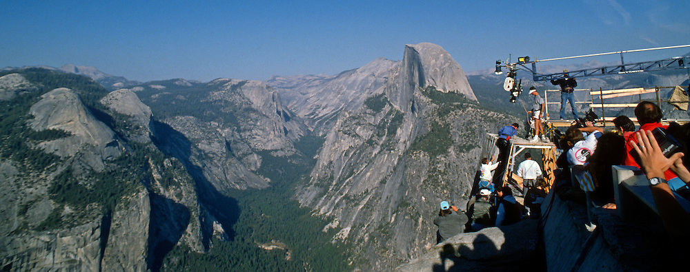 A film crew works on the movie Star Trek V in Yosemite National Park.  Leonard Nimoy (Spock) was on the set with El Capitan in the background; William Shatner (Capt. Kirk) was climbing a manufactured rock wall built on the edge of Glacier Point with Half Dome in the background.  October 13, 1988.