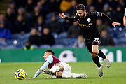 Manchester City midfielder Bernardo Silva (20) fouls Burnley midfielder Dwight McNeil (11) as he breaks away during the Premier League match between Burnley and Manchester City at Turf Moor, Burnley, England on 3 December 2019.