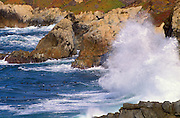 Crashing waves and rough surf along rocky shoreline on the Big Sur Coast, California