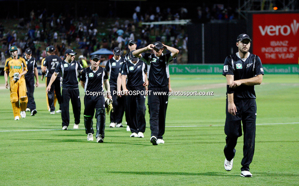 Daniel Vettori leads his team off the field after a convincing defeat to Australia.<br />3rd one day international. New Zealand Black Caps versus Australia one day Chappell Hadlee cricket series. Seddon Park, Hamilton, New Zealand. Tuesday 9 March 2010. Photo: Andrew Cornaga/PHOTOSPORT