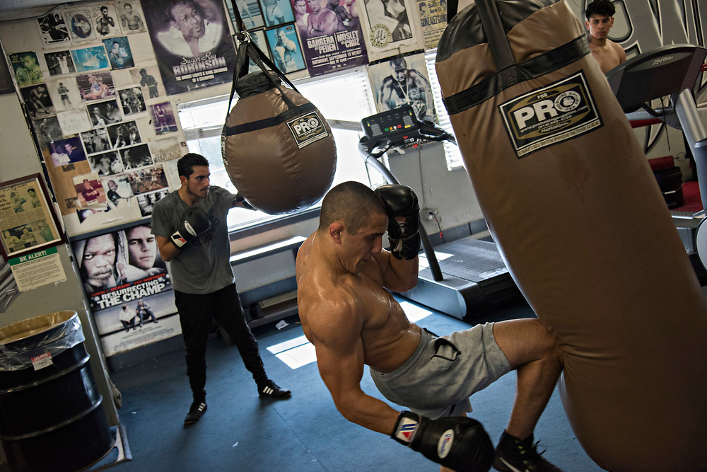 June 8, 2017 / Hollywood, Calif.<br /> <br /> Aaron Pico, 20, knees a heavy bag while training at the legendary Wild Card Boxing Club in Hollywood. (Melissa Lyttle for ESPN)