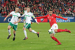 Switzerland's Haris Seferovic (right) hits a shot at goal during the FIFA World Cup Qualifying second leg match at St Jakob Park, Basel.
