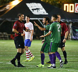 27 June 2015. New Orleans, Louisiana.<br /> National Premier Soccer League. NPSL. <br /> Jesters 1- Georgia Revolution 5.<br /> Referees controversially send 3 players off at one time, 2 Jesters and 1 Georgia player take the long walk from the field after a pushing and shoving incident as frustrations mount toward the end of the game.The New Orleans Jesters lose 1-5 to the Georgia Revolution in a lightning delayed game at home in the Pan American Stadium. <br /> Photo©; Charlie Varley/varleypix.com