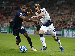BRITAIN-LONDON-FOOTBALL-CHAPIONS LEAGUE-HOTSPUR VS EINDHOVEN.(181106) -- LONDON, Nov. 6, 2018  Tottenham Hotspur's Harry Kane (R) vies with Eindhoven's Denzel Dumfries during the UEFA Champions League match between Tottenham Hotspur and PSV Eindhoven in London, Britain on Nov. 6, 2018. Tottenham Hotspur won 2-1.  FOR EDITORIAL USE ONLY. NOT FOR SALE FOR MARKETING OR ADVERTISING CAMPAIGNS. NO USE WITH UNAUTHORIZED AUDIO, VIDEO, DATA, FIXTURE LISTS, CLUBLEAGUE LOGOS OR ''LIVE'' SERVICES. ONLINE IN-MATCH USE LIMITED TO 45 IMAGES, NO VIDEO EMULATION. NO USE IN BETTING, GAMES OR SINGLE CLUBLEAGUEPLAYER PUBLICATIONS. (Credit Image: © Xinhua via ZUMA Wire)