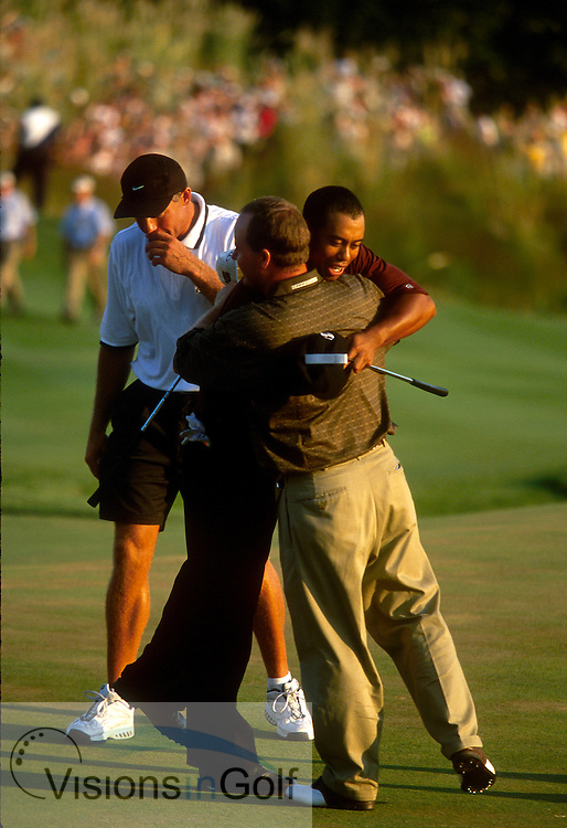 Playoff: Tiger Woods is hugged by Bob  May after winning the playoff on #18 the first playoff hole.<br />