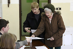 Voters register their personal information at a polling station in Bratislava, Slovakia, March 5, 2016. The ninth general election in Slovakia's history kicked off at 7 a.m. local time (0600 GMT) Saturday, with some 4.4 million eligible voters expected to cast their vote in 5,992 polling stations nationwide for the 150-member parliament. EXPA Pictures © 2016, PhotoCredit: EXPA/ Photoshot/ Andrej Klizan<br />