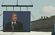 A 10.6 MG IMAGE OF:.Arlington, VA  President GW Bush speaking at Pentagon 911 ceremony while Secret Service  team keeps watch. Photo by Dennis Brack