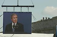 A 10.6 MG IMAGE OF:.Arlington, VA  President GW Bush speaking at Pentagon 911 ceremony while Secret Service  team keeps watch. Photo by Dennis Brack