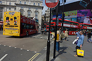 The M&M brand appears as an advert on the rear of a London tour bus travelling through the capital's streets, through through Piccadilly Circus.