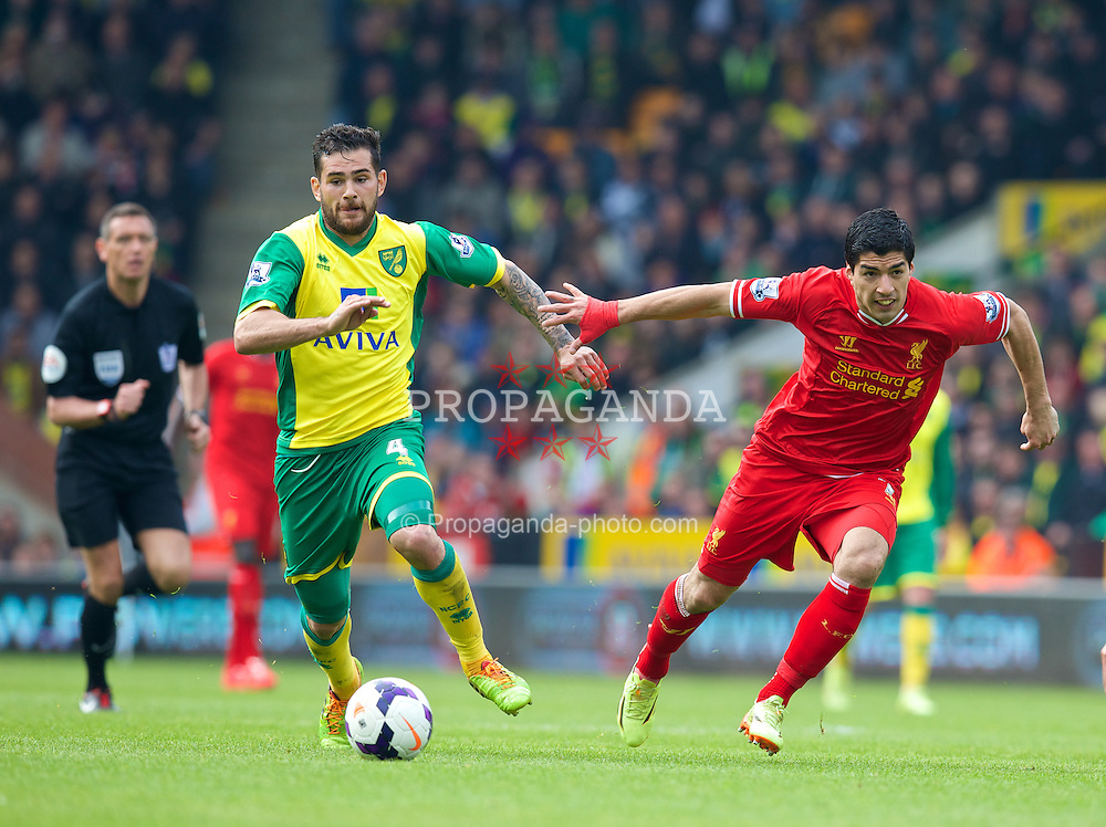 NORWICH, ENGLAND - Sunday, April 20, 2014: Liverpool's Luis Suarez in action against Norwich City during the Premiership match at Carrow Road. (Pic by David Rawcliffe/Propaganda)