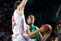 Omer Asik of Turkey vs Goran Dragic of Slovenia during the quarter-final basketball match between National teams of Turkey and Slovenia at 2010 FIBA World Championships on September 8, 2010 at the Sinan Erdem Dome in Istanbul, Turkey.  (Photo By Vid Ponikvar / Sportida.com)