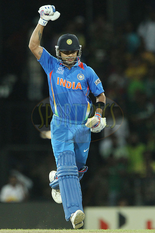 Virat Kholi celebrates the win during the ICC World Twenty20 Super 8s match between India and Pakistan held at the Premadasa Stadium in Colombo, Sri Lanka on the 30th September 2012..Photo by Ron Gaunt/SPORTZPICS