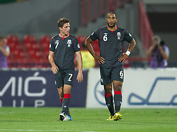 NOVI SAD, SERBIA - Tuesday, September 11, 2012: Wales' Joe Allen and Ashley Williams look dejected as Serbia score the third goal during the 2014 FIFA World Cup Brazil Qualifying Group A match at the Karadorde Stadium. (Pic by David Rawcliffe/Propaganda)