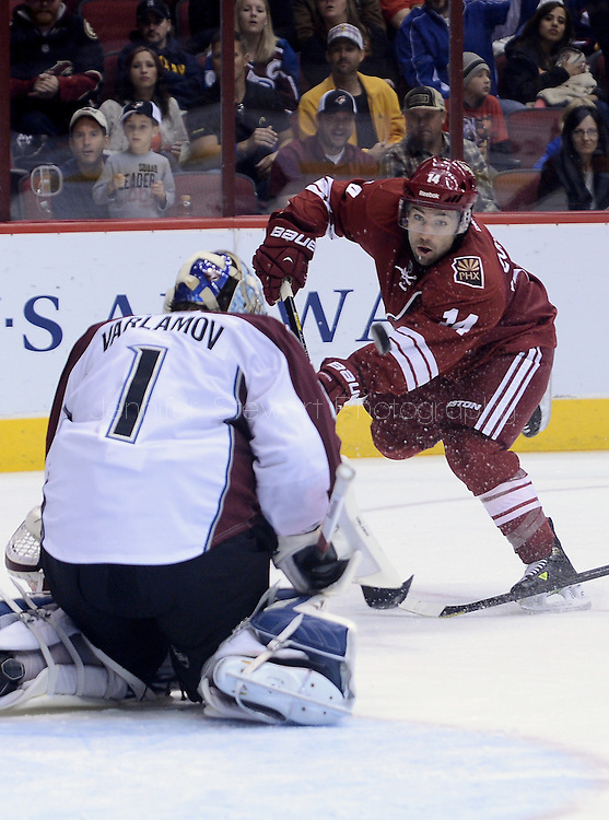 Apr. 6, 2013; Glendale, AZ, USA;  Phoenix Coyotes forward Chris Conner (14) shoots the puck in the second period against the Colorado Avalanche goalie Semyon Varlamov (1) at Jobing.com Arena. The Coyotes defeated the Avalanche 4-0.  Mandatory Credit: Jennifer Stewart-USA TODAY Sports
