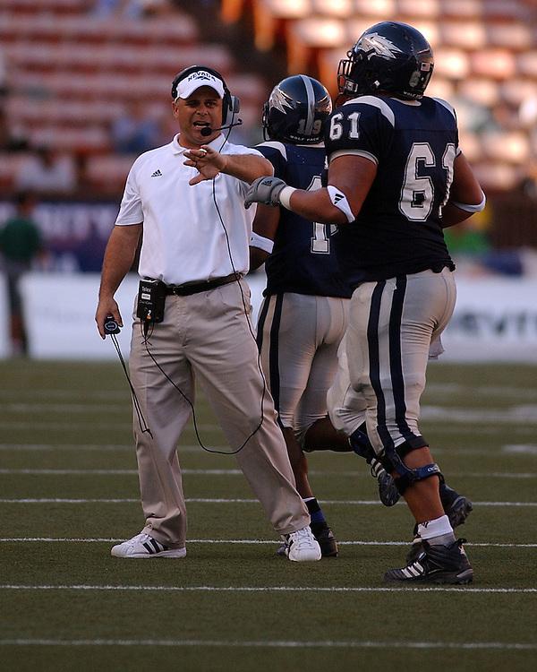 Nevada assistant coach Mike Mastro congratulates his players during the 2005 Sheraton Hawai'i Bowl at Aloha Stadium in Honolulu, Dec. 24, 2005.<br />