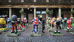 © Licensed to London News Pictures. 24/09/2015. London, UK. People look at some of the 120 Shaun the Sheep sculptures placed in Covent Garden market ahead of their auction. The auction on the 8th October 2015 will raise funds for the  Wallace & Gromit's Children's Charity supporting children's hospitals and hospices throughout the UK.  Photo credit: Peter Macdiarmid/LNP