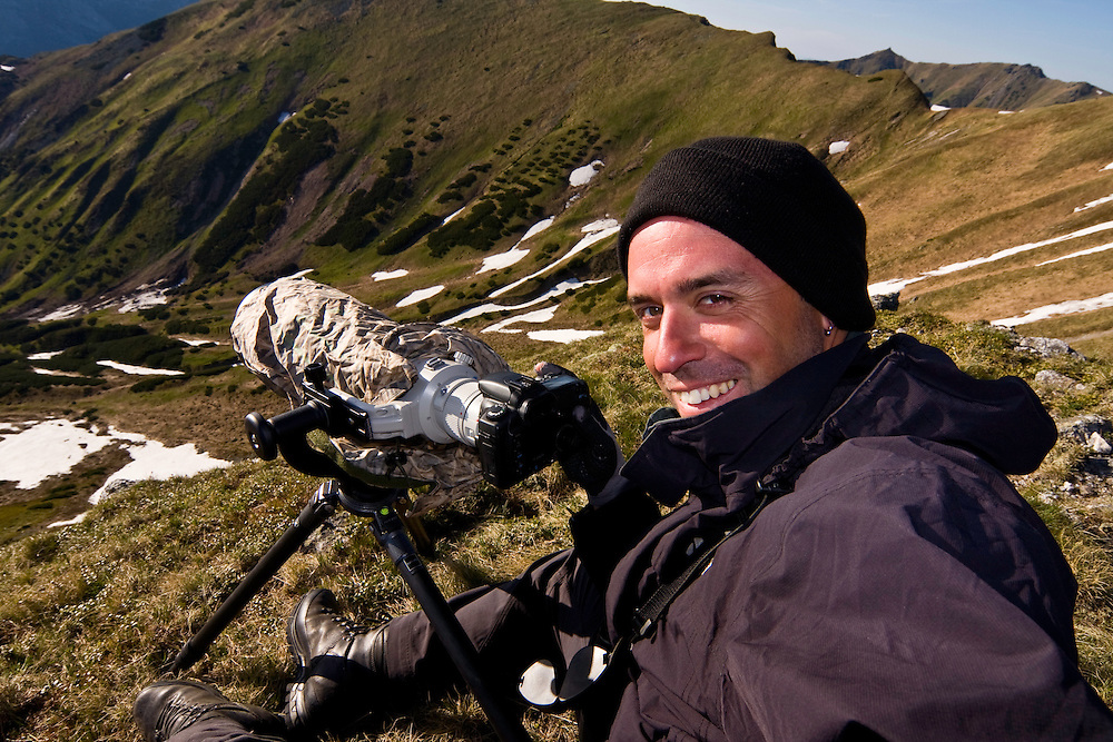 The photographer Bruno D'Amicis at work in a mountain valley. Western Tatras, Slovakia. June 2009. Mission: Ticha