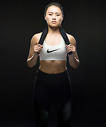 Asian young woman in sportswear poses in the studio on 29 June 2017, in Hong Kong, China. Photo by Victor Fraile / Illume Visuals