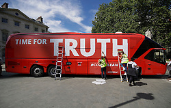 "© Licensed to London News Pictures. 18/07/2016. London, UK. A bus used by the Leave campaign during the EU referendum, rebranded by Greenpeace outside the Houses of Parliament in London. The ""Brexit Bus"" was previously covered in a slogan claiming that £350 million sent to the EU could be spent on the NHS.  Photo credit: Peter Macdiarmid/LNP"