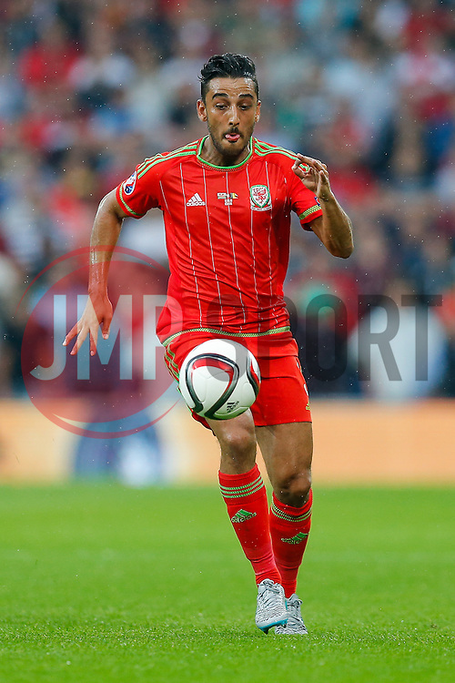 Neil Taylor of Wales (Swansea City) in action - Photo mandatory by-line: Rogan Thomson/JMP - 07966 386802 - 12/06/2015 - SPORT - FOOTBALL - Cardiff, Wales - Cardiff City Stadium - Wales v Belgium - EURO 2016 Qualifier.