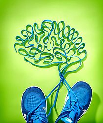 Trainers with shoe laces in a shape of the brain. Being active shapes your brain.