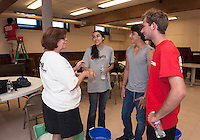 Pastor Paula Gile, Ana Ulibarri from Mexico, Alan Slucki from Mexico and Jacob Dickson from Arizona prepare for their days work of community service painting and cleaning at the Congregational Church Wednesday morning.  (Karen Bobotas/for the Laconia Daily Sun)