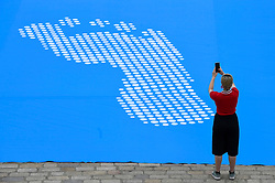 © Licensed to London News Pictures. 24/06/2019. LONDON, UK.  A woman takes a photo at an opening event at Somersert House for Fly The Flag, a major new project marking the 70th anniversary of the Universal Declaration of Human Rights for which artist and activist Ai Weiwei has designed a new flag.  Photo credit: Stephen Chung/LNP