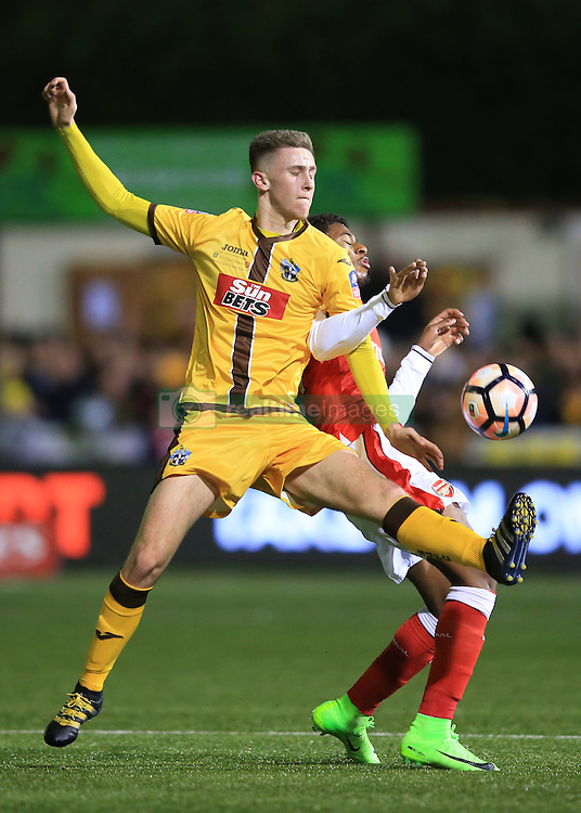 20 February 2017 - The FA Cup - (5th Round) - Sutton United v Arsenal - Adam May of Sutton United in action with Jeff Reine-Adelaide of Arsenal - Photo: Marc Atkins / Offside.
