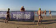 2010 Noosa Triathlon Festival.ENDURA Noosa Run Swim Run.Junior competitors finish the first leg of the run swim run..27/10/2010.Noosa Main Beach, Noosa, Queensland, Australia.