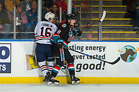 KELOWNA, CANADA - SEPTEMBER 22: Zane Franklin #16 of the Kamloops Blazers is checked by Jack Cowell #8 of the Kelowna Rockets  on September 22, 2018 at Prospera Place in Kelowna, British Columbia, Canada.  (Photo by Marissa Baecker/Shoot the Breeze)  *** Local Caption ***