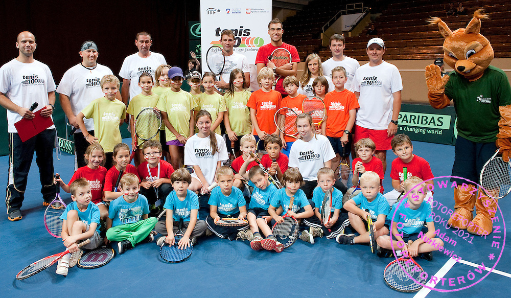 "(L) Lukasz Kubot & (R) Jerzy Janowicz both from Poland pose with children after training session ""Tenis 10"" during the BNP Paribas Davis Cup 2012 between Poland and Belarus at MOSiR Hall in Lodz on September 15, 2012...Poland, Lodz, September 15, 2012..Picture also available in RAW (NEF) or TIFF format on special request...For editorial use only. Any commercial or promotional use requires permission...Photo by © Adam Nurkiewicz / Mediasport"