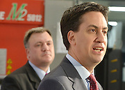© Licensed to London News Pictures. 27/11/2012. Stevenage, UK ED BALLS (left) watches ED MILIBAND talk. Ed Miliband MP, Leader of the Labour Party and Ed Balls MP, Labours Shadow Chancellor hold a joint question and answer session at Propak Sheet Metal LTD in Stevenage, today 27th November 2012, ahead of the Autumn Statement. Photo credit : Stephen Simpson/LNP