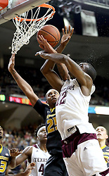 Texas A&M's JAlen Jones (12) is fouled by Missouri's Russell Woods (25) while shooting during the first half of an NCAA college basketball game, Saturday, Jan. 23, 2016, in College Station, Texas.  (AP Photo/Sam Craft)