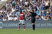 Referee Robert Jones issues a yellow card to Famara Diédhiou of Bristol City during the EFL Sky Bet Championship match between Sheffield Wednesday and Bristol City at Hillsborough, Sheffield, England on 22 April 2019.