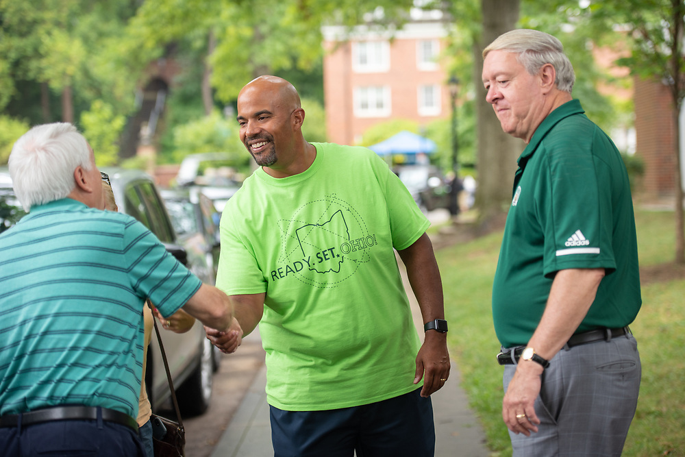Vice President for Student Affairs Jason Pina (Center) and University President M. Duane Nellis (Right) greet the parent of a first year student at move- in day at a residence hall on East Green.
