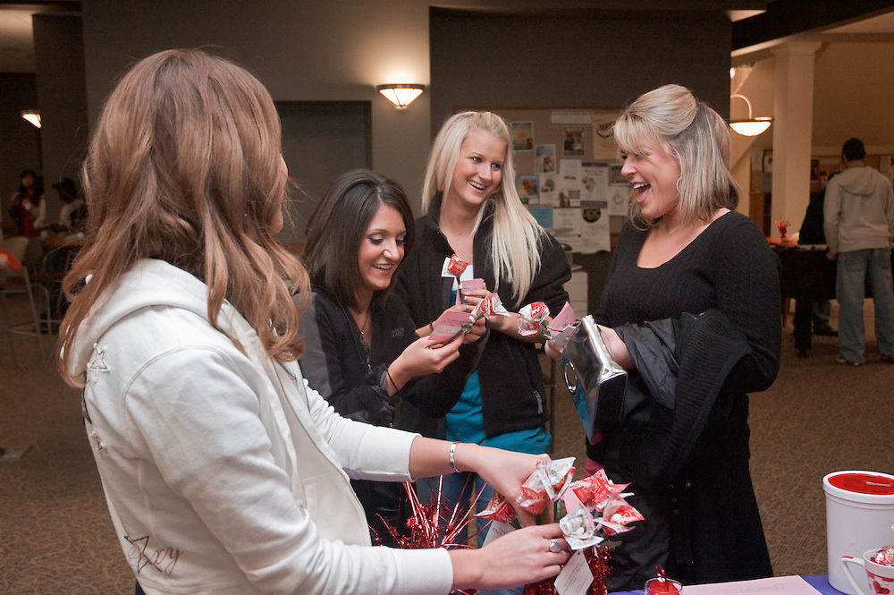 From left to right: Raven Printz, Brittany Plundo, Briana Walter, Brittany Reynolds laugh over the rose-shaped condom arrangements at the Single, Safe, Sexy Social.