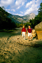 CA: Yosemite National Park, Young couple hiking near Mirror Lake, model released     .Photo Copyright: Lee Foster, lee@fostertravel.com, www.fostertravel.com, (510) 549-2202.cayose233.