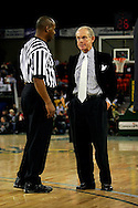 25 November 2005: 2004 SEC Coach of the Year, Dave Odom of the University of South Carolina listens to a referee in the Gamecock's 62-56 victory over Monmouth University at the Great Alaska Shootout in Anchorage, Alaska