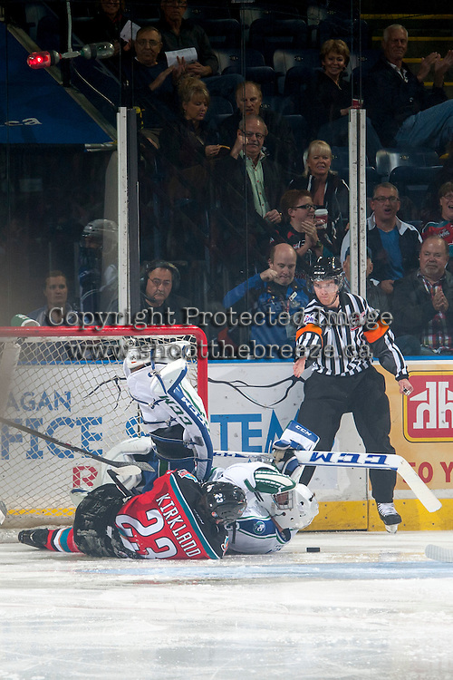 KELOWNA, CANADA - OCTOBER 7: Justin Kirkland #23 of Kelowna Rockets slides into Landon Bow #30 of Swift Current Broncos after scoring a goal in the first period on October 7, 2014 at Prospera Place in Kelowna, British Columbia, Canada.  (Photo by Marissa Baecker/Getty Images)  *** Local Caption *** Justin Kirkland; Landon Bow;