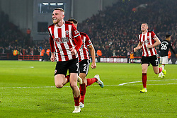 Oliver McBurnie of Sheffield United celebrates scoring a goal to make it 3-3 - Mandatory by-line: Robbie Stephenson/JMP - 24/11/2019 - FOOTBALL - Bramall Lane - Sheffield, England - Sheffield United v Manchester United - Premier League