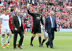 John Terry (left), Harry Redknapp (second left), Edwin van der Sar (second right) and Sir Alex Ferguson (right) during Michael Carrick's Testimonial match at Old Trafford, Manchester.