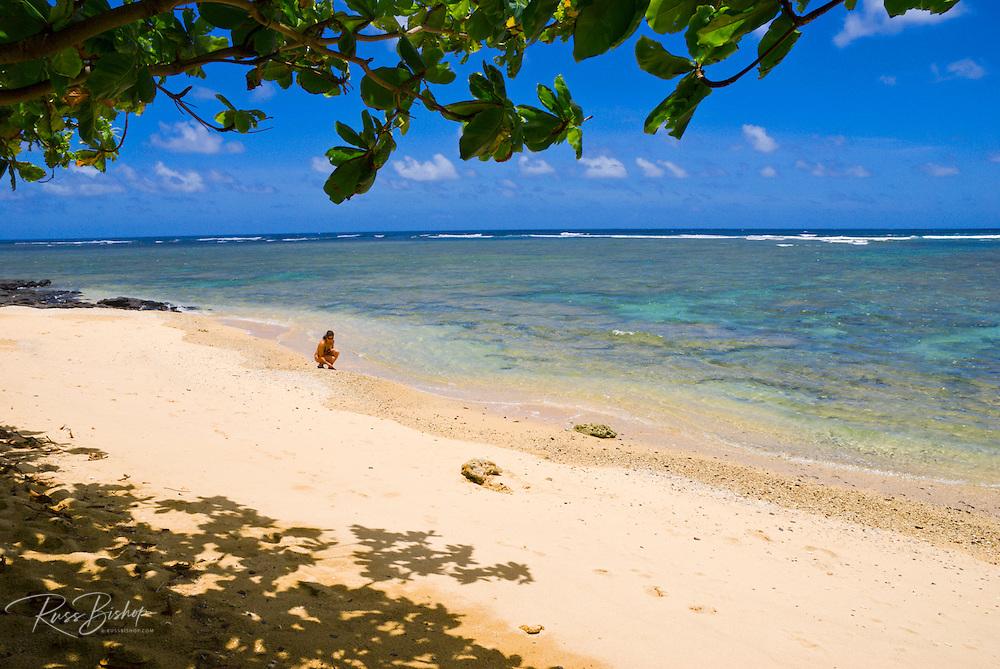 Woman on a beach at Kalihiwai Bay, North Shore, Island of Kauai, Hawaii