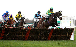 Metatrons Cube ridden by Stan Sheppard (right) competes in the Watch Racing TV with Free Trial Now Handicap Hurdle during Midlands Raceday at Warwick Racecourse.