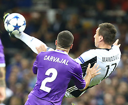 June 3, 2017 - Cardiff, Walles, United Kingdom - Mario Mandzukic of Juventus FCscores his sides equalising goal to make the score 1-1 during the UEFA Champions League -  Final match between Real Madrid and Juventus  at  National Wales Stadium in Cardiff, Wales on June 03, 2017  (Credit Image: © Kieran Galvin/NurPhoto via ZUMA Press)